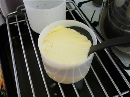 Placing curd in moulds